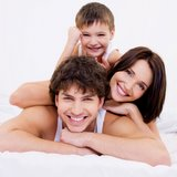 smiling family on bed