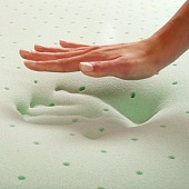 hand making impression in memory foam