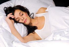 woman sleeping on comfortable memory foam mattress