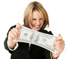 woman stretching a hundred dollar bill